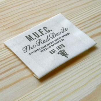 """Этикетка из натуральной ткани """"M.U.F.C."""" 6,5х5,5 см"""
