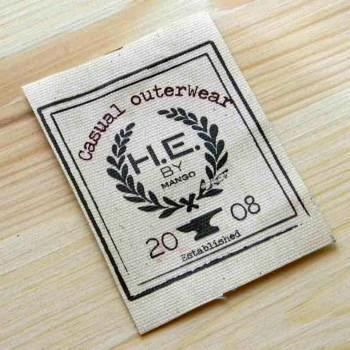 """Этикетка на натуральной ткани печатная """"H.E"""" 6,5х9 см"""