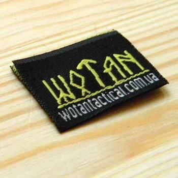"""Пришивная этикетка  с логотипом производителя """"Wotan"""" 3,2х4,2 см"""