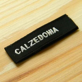 """Тканый размерник-флажок с лого """"Calzedonia"""" 8х1 см"""